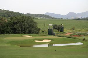 Water hazard in front of a green