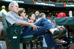 Former President George W. Bush and former First Lady Laura Bush watch a baseball game