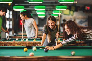 Girls playing pool