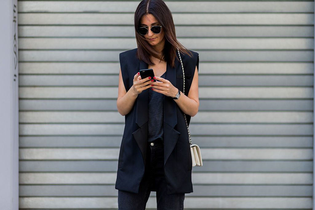 Street style vest and skinny jeans