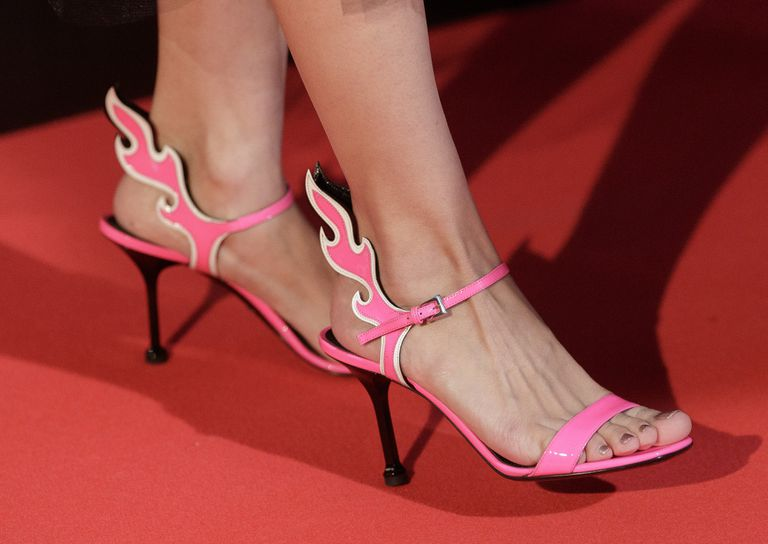 Strappy pink flame stiletto sandals on a woman's feet