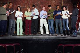 group of people standing on stage