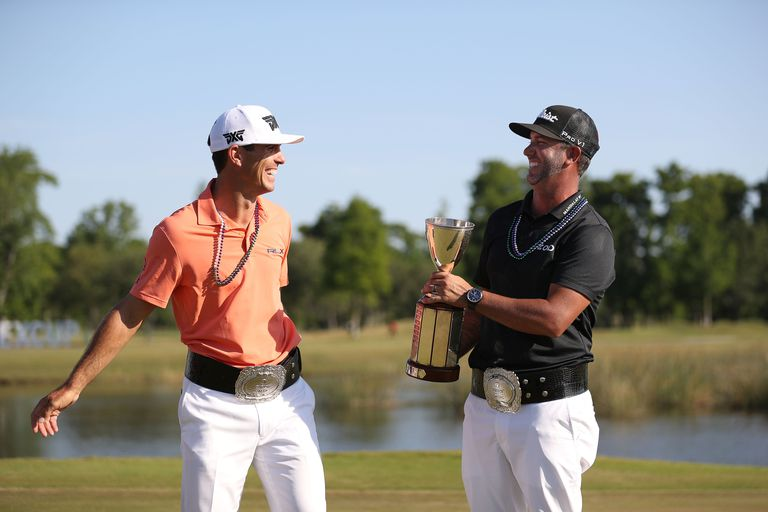 Billy Horschel and Scott Piercy pose with the trophy and commerative belts during the final round of the 2018 Zurich Classic