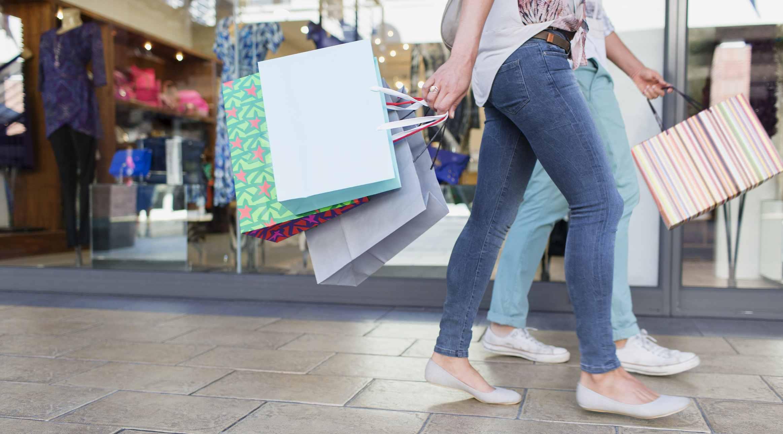 women with shopping bags walking