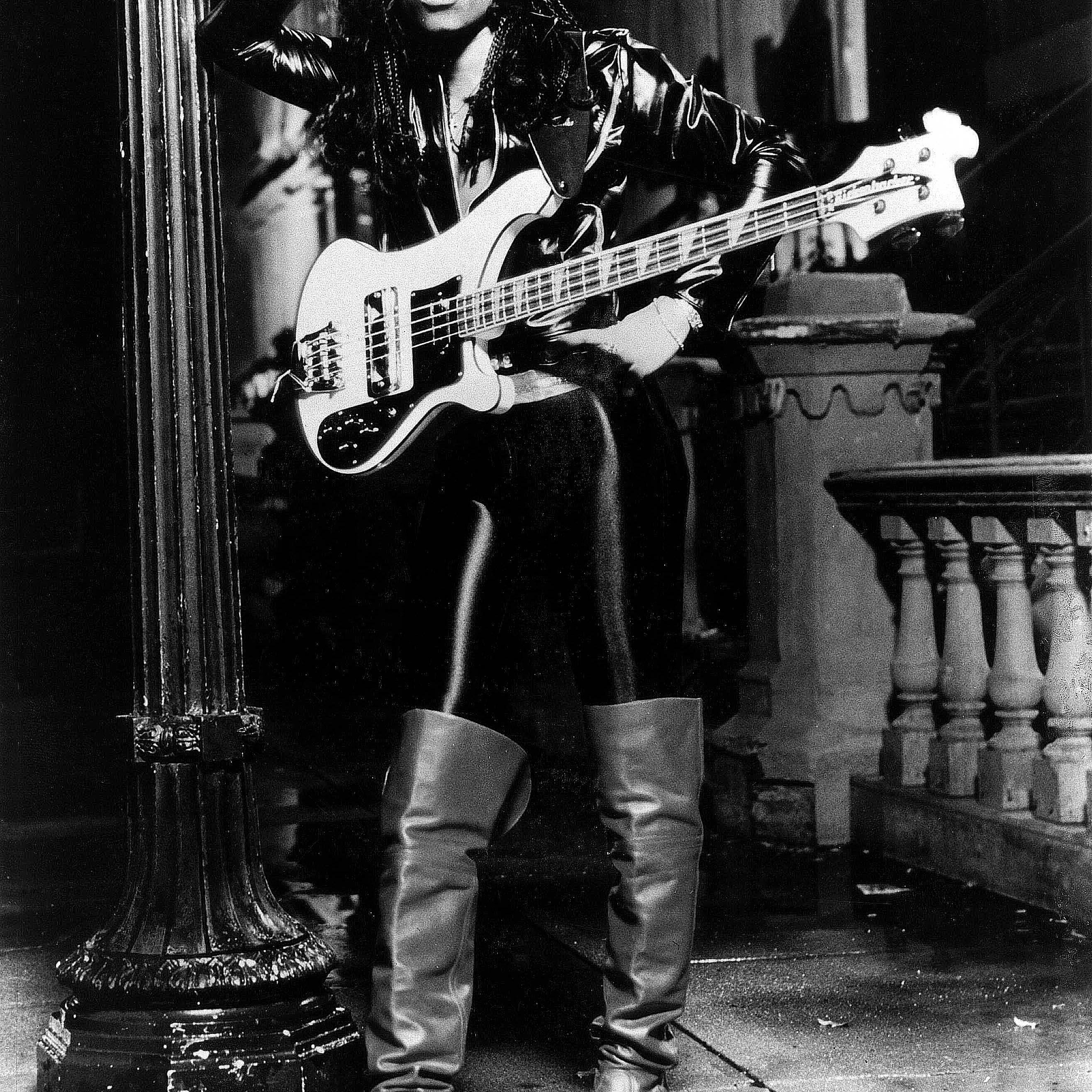 Rick James posing with guitar.