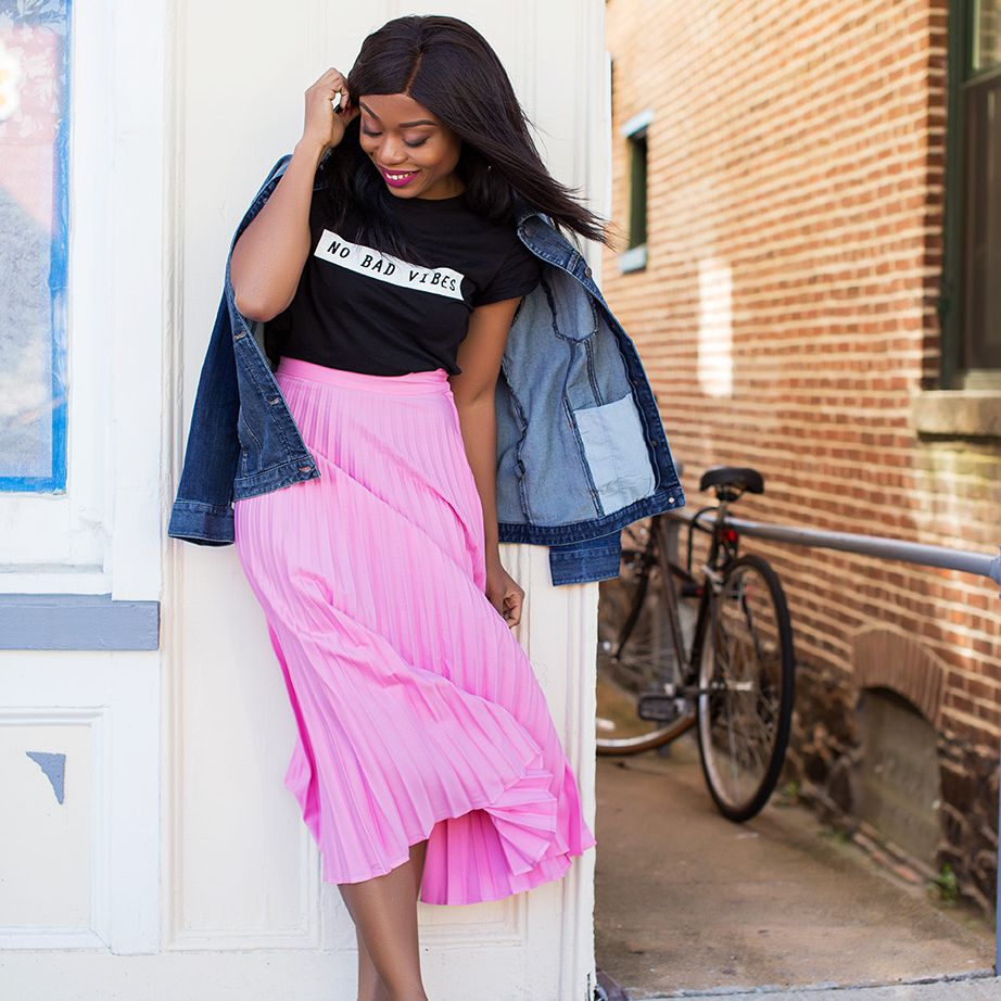 Woman in Pink Pleated Skirt and Jean Jacket