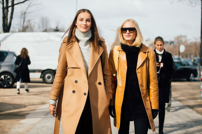 Two women wearing camel coats