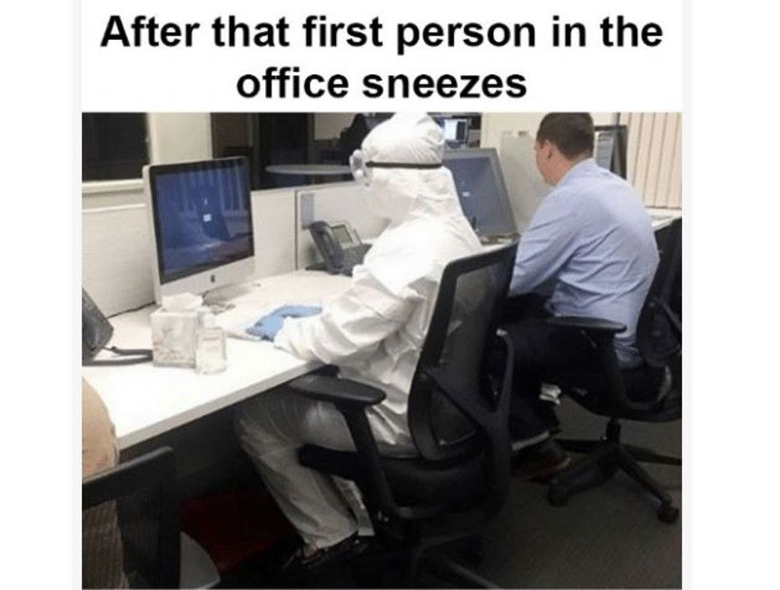Person in hazmat suit at computer