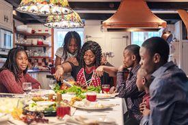 African-American preparing thanksgiving dinner