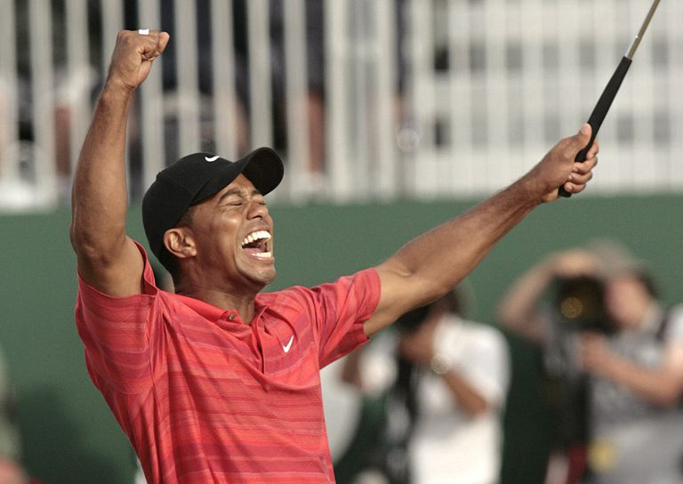 Tiger Woods celebrates on the 18th green after winning the 135th Open Championship at Royal Liverpool Golf Club in Hoylake, Great Britain on July 23, 2006