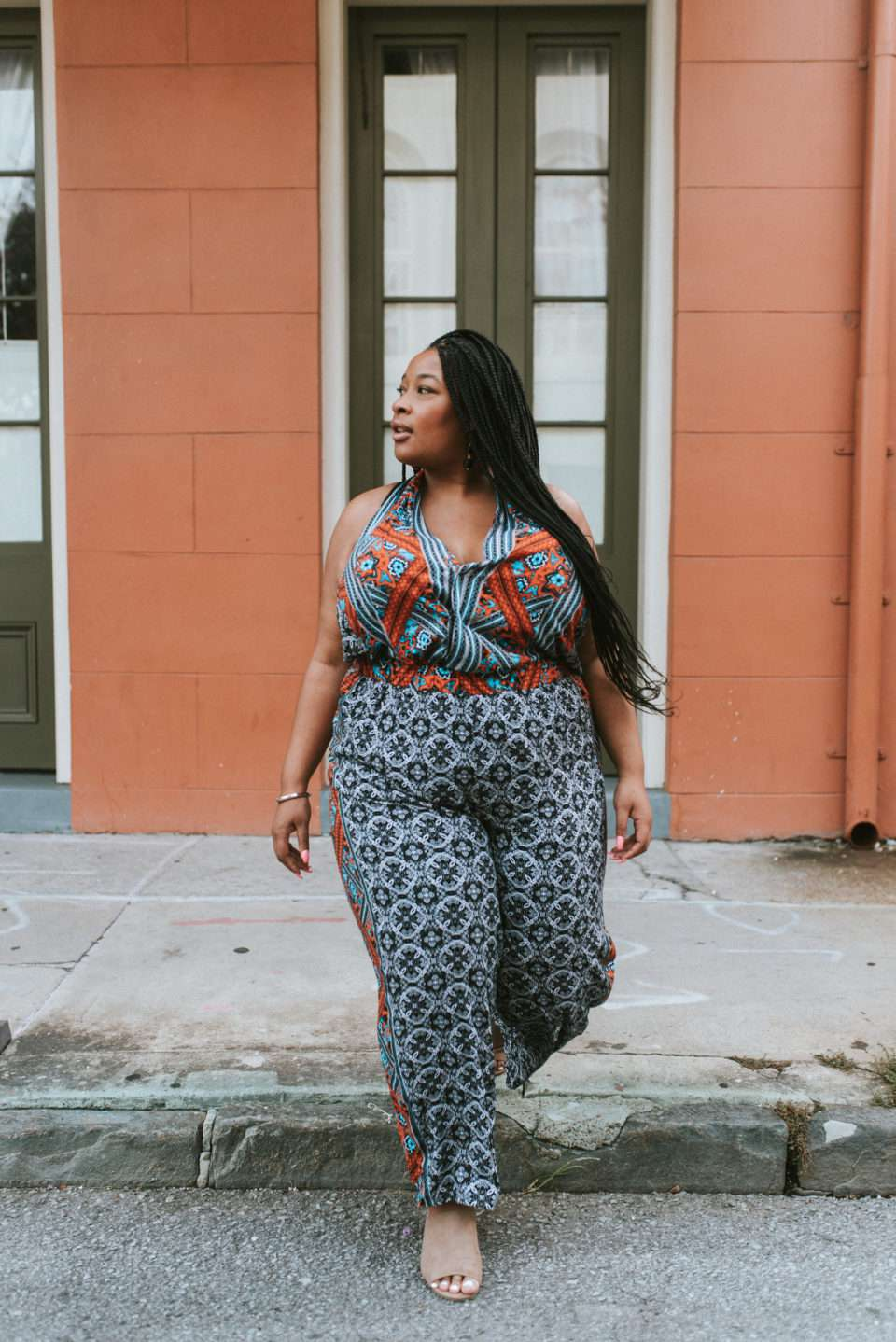 Woman in a printed jumpsuit for summer style