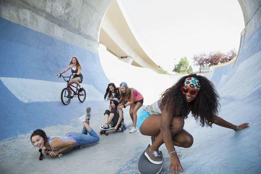 Teenage girls skateboarding