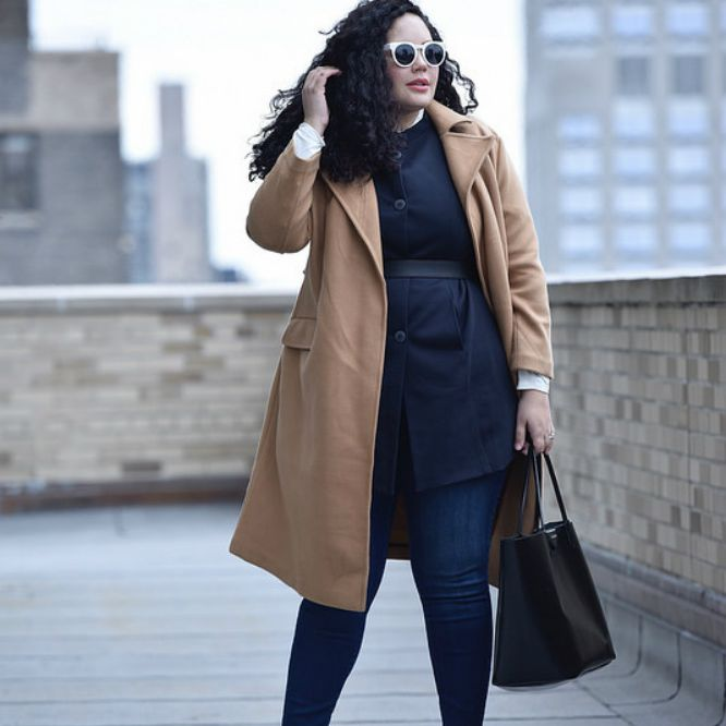 Woman in black outfit and camel coat for fall