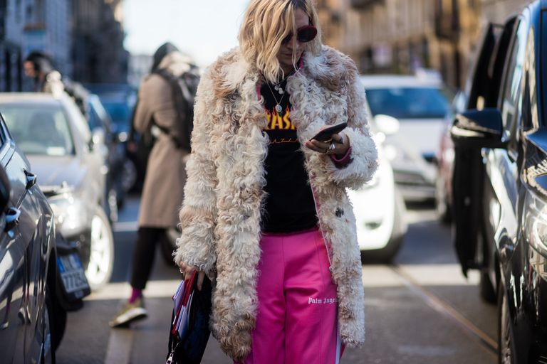 fb5513e6f1b86 Street style fur coat and track pants. We round up the best winter coats ...
