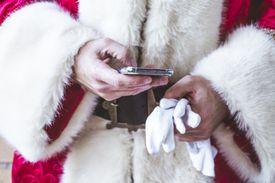 Santa Claus using smart phone