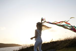 Girl with Ribbons waving in the air
