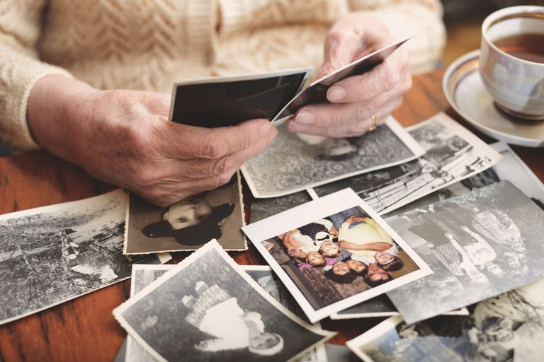 An older woman looking through photos