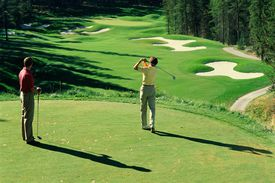Scenic Golf Course With Golfers and Sand Traps