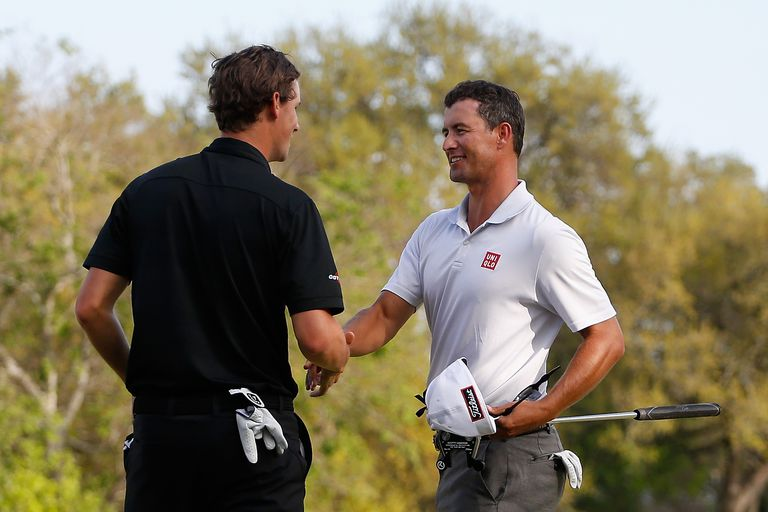 Thomas Pieters and Adam Scott shake hands after a halved match