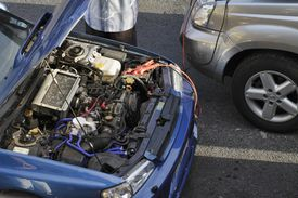 Car engine jump start between two vehicles