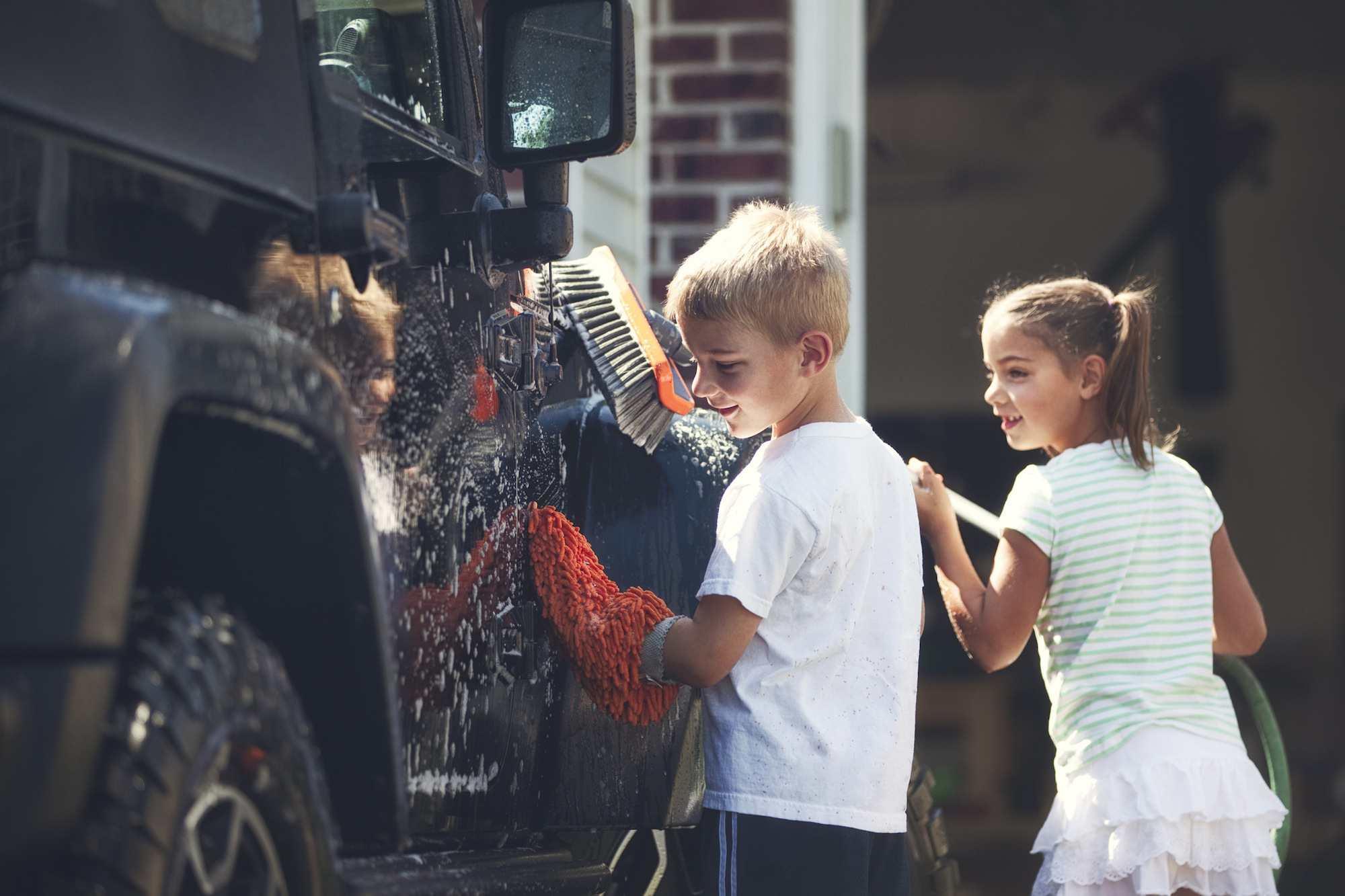 Children washing a car