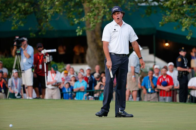 Phil Mickelson reacts to missing a putt during the U.S. Open tournament.