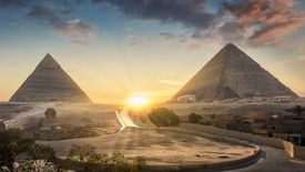 View of The Great Sphinx, Pyramid of Khafre and Great Pyramid of Giza at sunset, Cairo, Giza, Egypt
