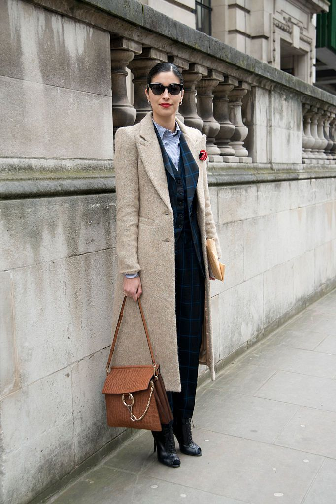Chief Executive of Tank Magazine Caroline Issa wears a Temple Smith suit jacket on day 3 of London Collections: Women on February 22, 2015 in London, England.
