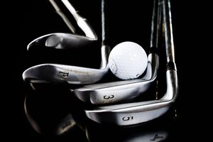 golf irons with cambered soles