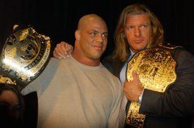 Kurt Angle and Triple H with championship belts.