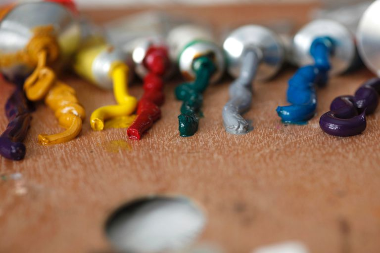 Tubes of paint squeezed onto palette