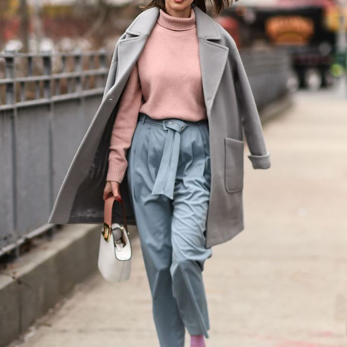 Street style woman in pink and blue outfit for fall