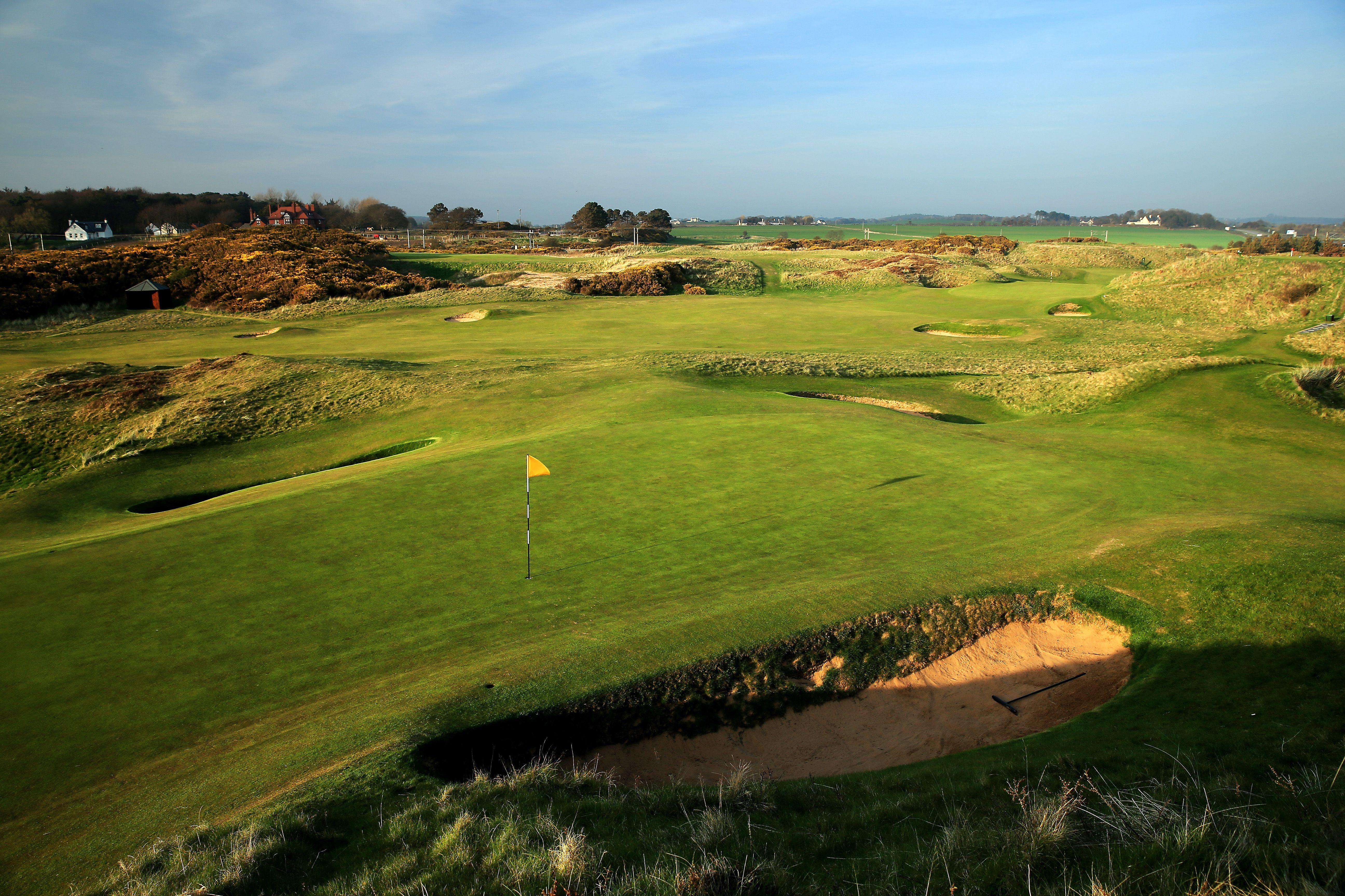 The green on the par 3, 8th hole The Postage Stamp with the par 4, 7th hole behind on the Old Course at Royal Troon
