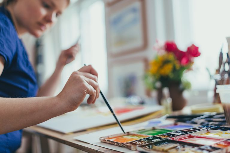 Woman painting with watercolor