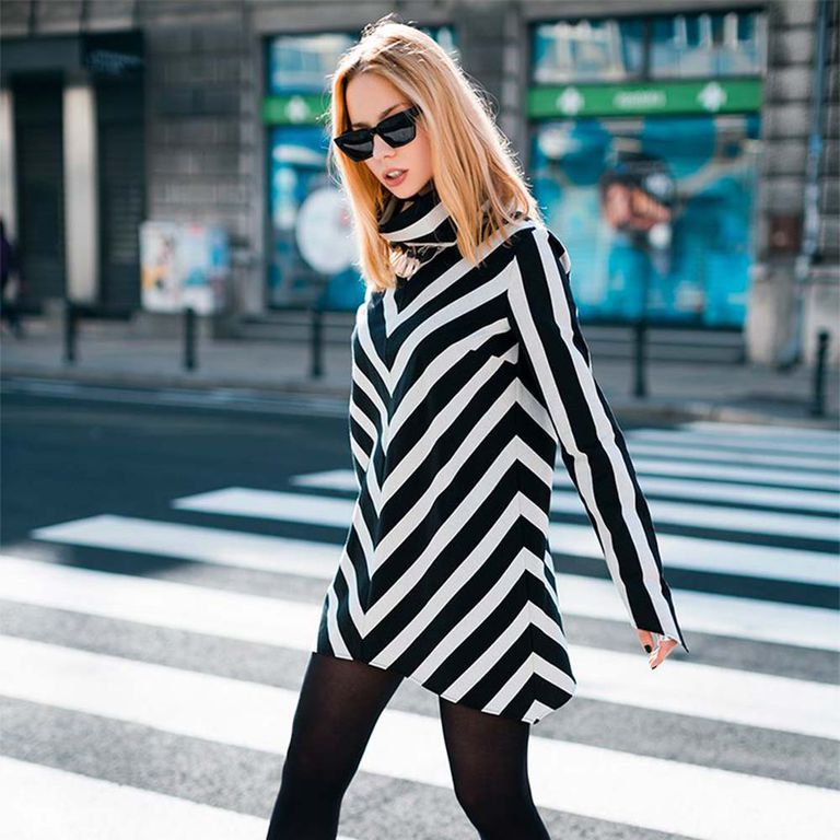 person wearing chevron print top and sunglasses in the city