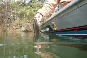 crappie fishing on a boat in a muddy lake