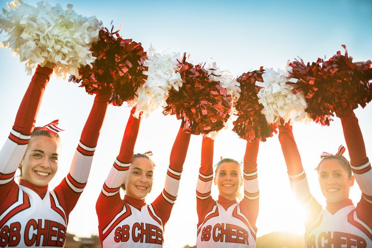Cheerleaders holding up pom poms