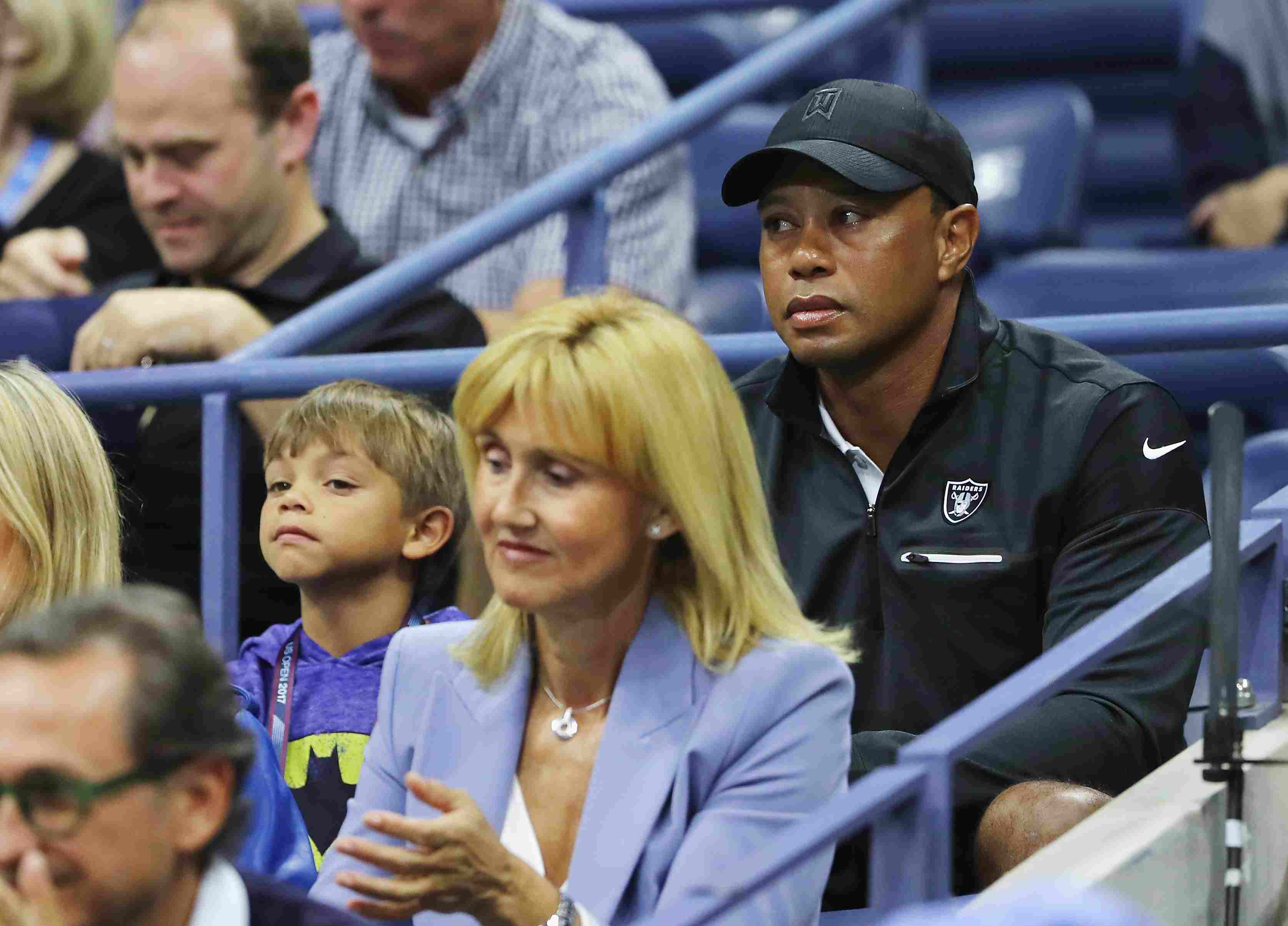 Professional golfer Tiger Woods (R) and his son Charlie Axel Woods (L) attend Day Twelve of the 2017 US Open at the USTA Billie Jean King National Tennis Center