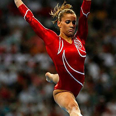 Gymnast Alicia Sacramone on beam at the 2008 Olympics