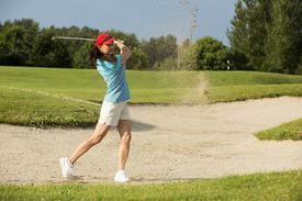 A woman playing a round of golf.