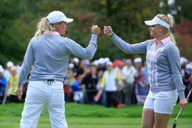 Charley Hull of the European Team celebrates with her partner Suzann Pettersen.