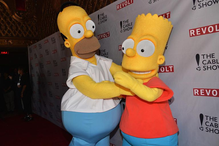 People in Homer and Bart Simpson costumes