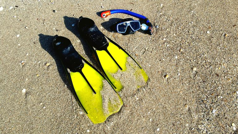 Scuba gear in the sand
