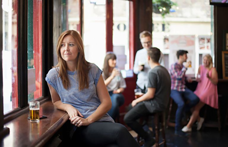 Woman in a pub alone