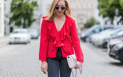 64089e7ec3 Street style woman in red blouse and jeans