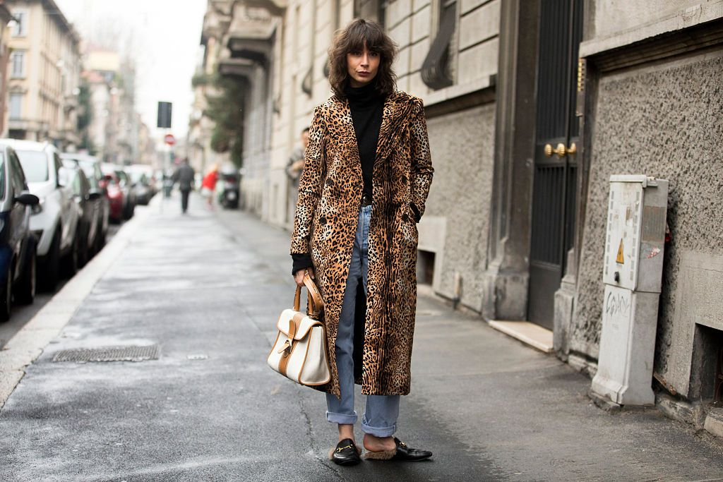 Woman wearing leopard coat and cropped jeans