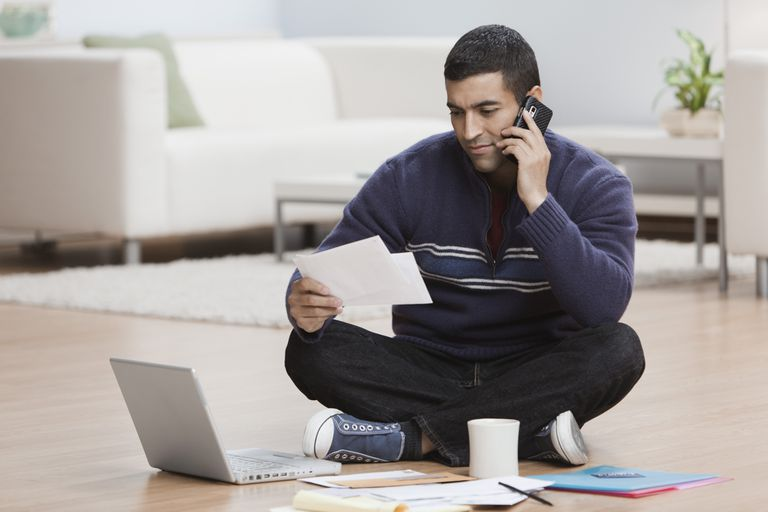 Man Looking at a Check He Received in the Mail