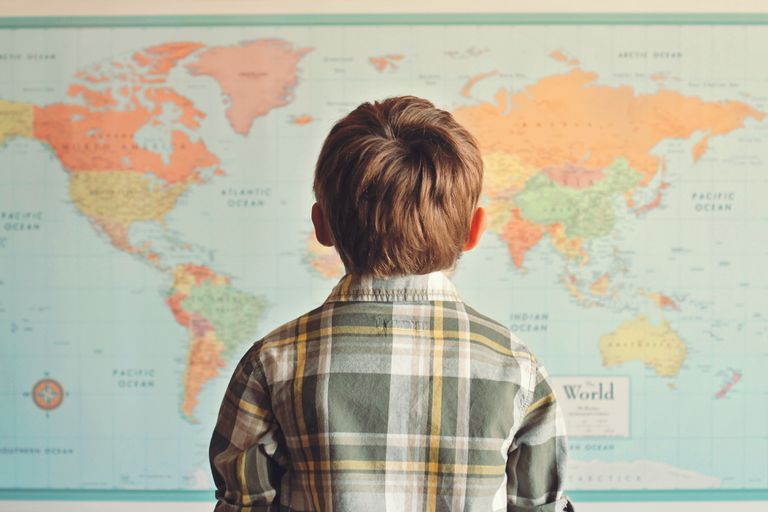 Image of a Boy Looking at a Map