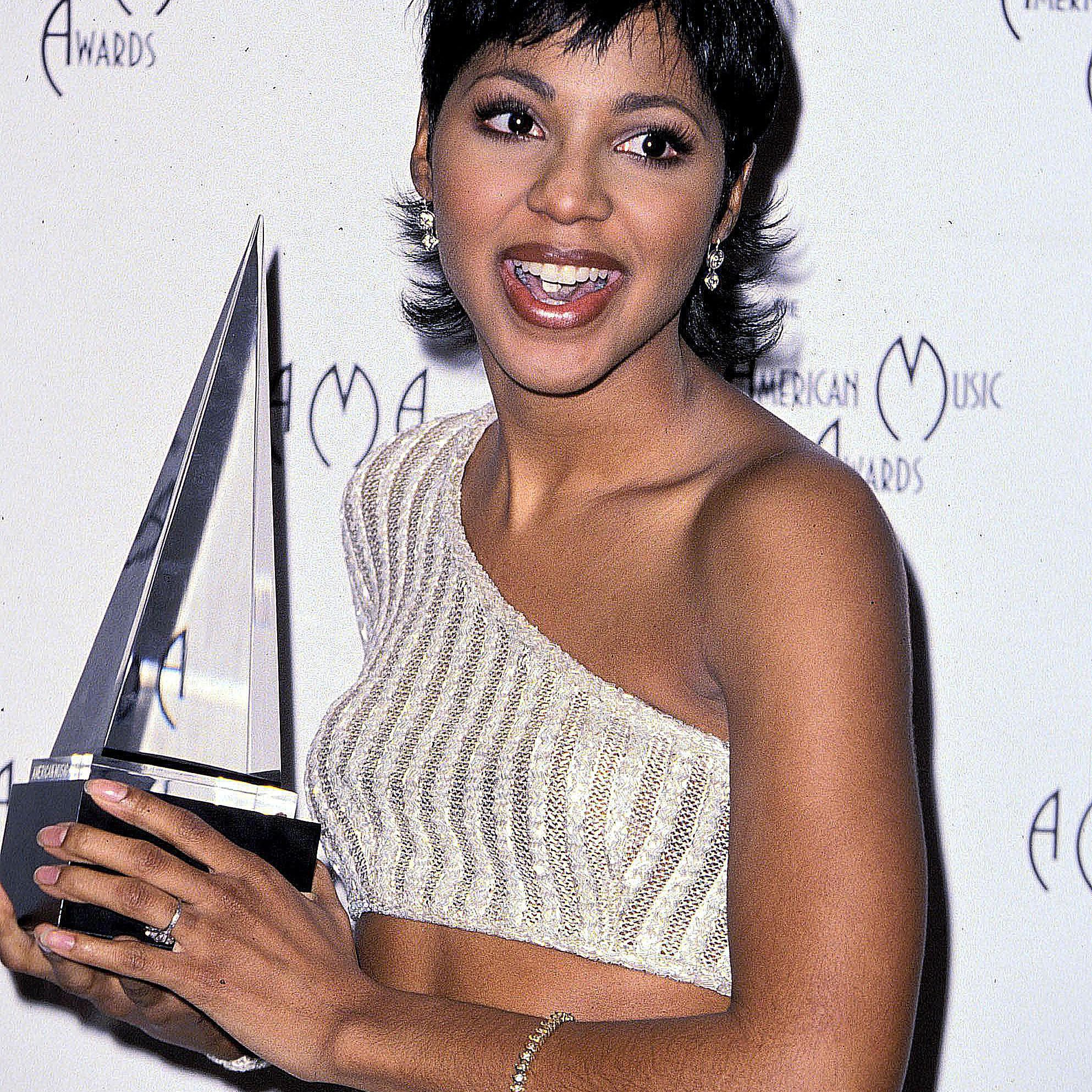 Toni Braxton accepting an American music award