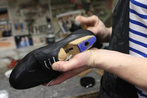 Shoe maker making a pair of leather shoes